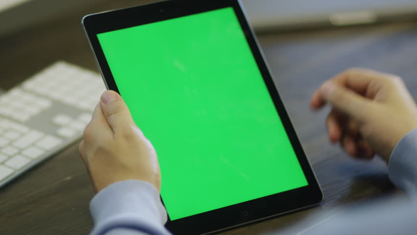 Designer using Digital Tablet with Green Screen at Work in Portrait Mode Shot on RED Camera in 4K, so you can easily crop, rotate and zoom. ProResHQ codec  - Great for editing, color correction | Shutterstock HD Video #7315450