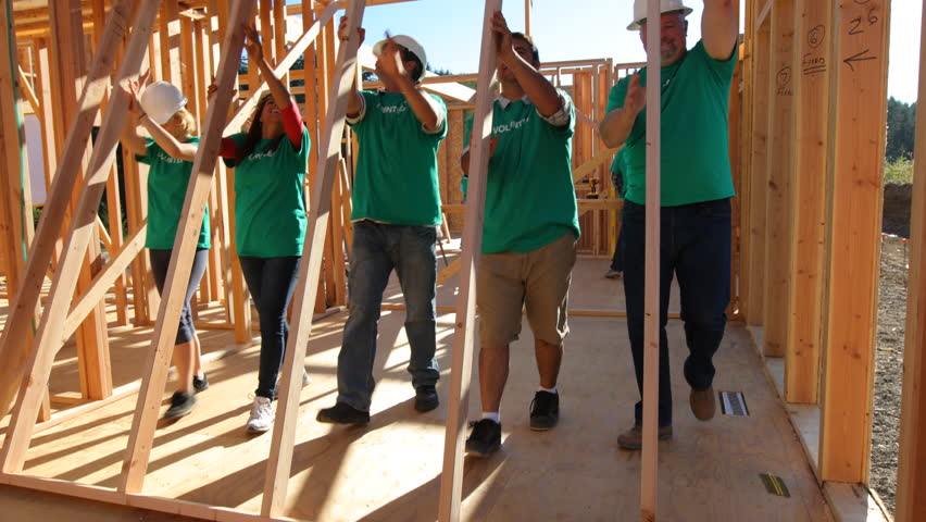 Volunteers working together lifting wall | Shutterstock HD Video #7332973
