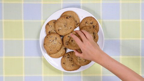 Plate full of cookies being snatched up by four children. Clip is 2x normal frame rate.