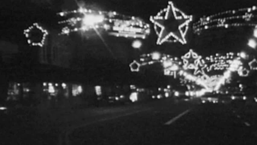 HOLLYWOOD CALIFORNIA - December 2:  Vintage super 8 night time lapse footage of Christmas holiday lights and traffic along Hollywood Blvd in Los Angeles, California.
