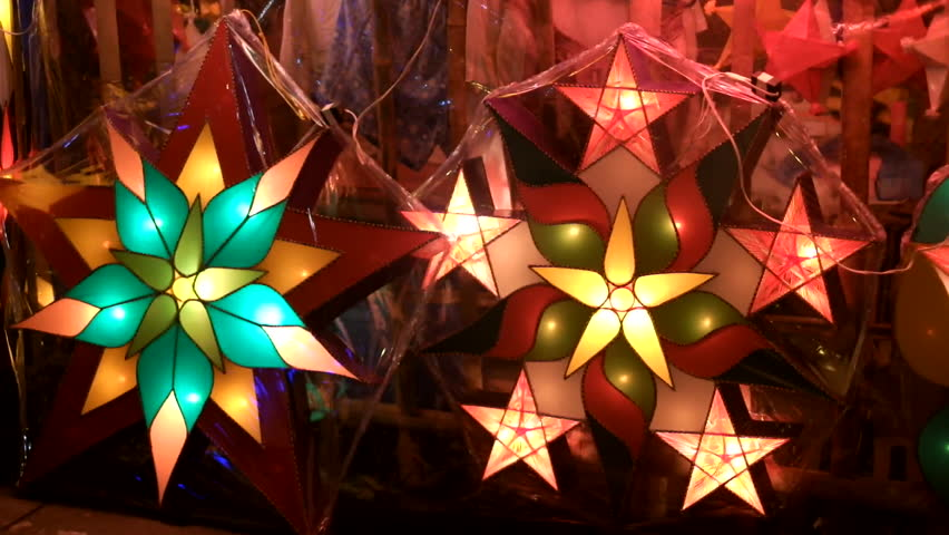 filipino parol or christmas star lanterns for sale in the streets traditionally assembled and sold in the philippines during holidays - Filipino Christmas Star