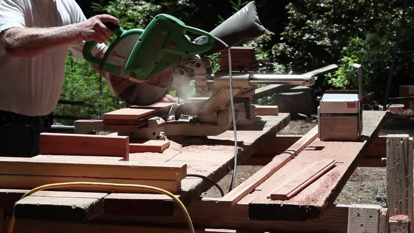 Man Cutting Wood At Construction Site.   HD Stock Footage Clip
