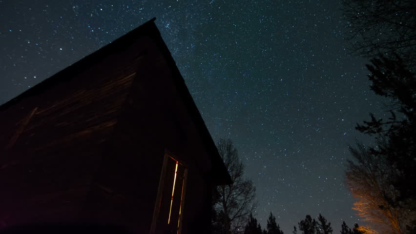 Night Sky Time Lapse With Old Wood Cabin