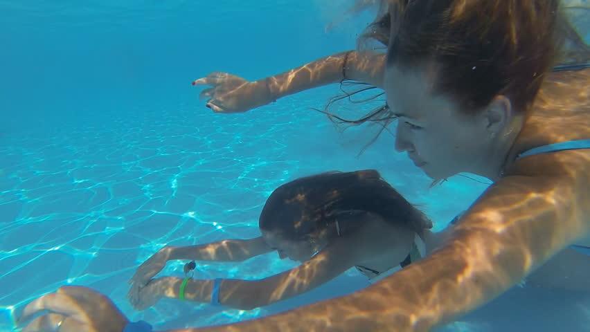 Beautiful Slender Girls Swim Underwater Stock Footage -2562