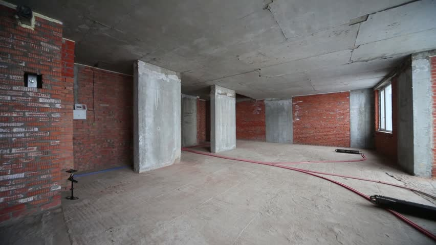 Apartment With Concrete Floor In Building Under