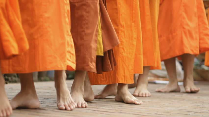 monks  doing there  alms rounds in lao