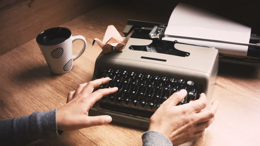 My old typewriter back for some retro typing with a nice cup of coffee and origami
