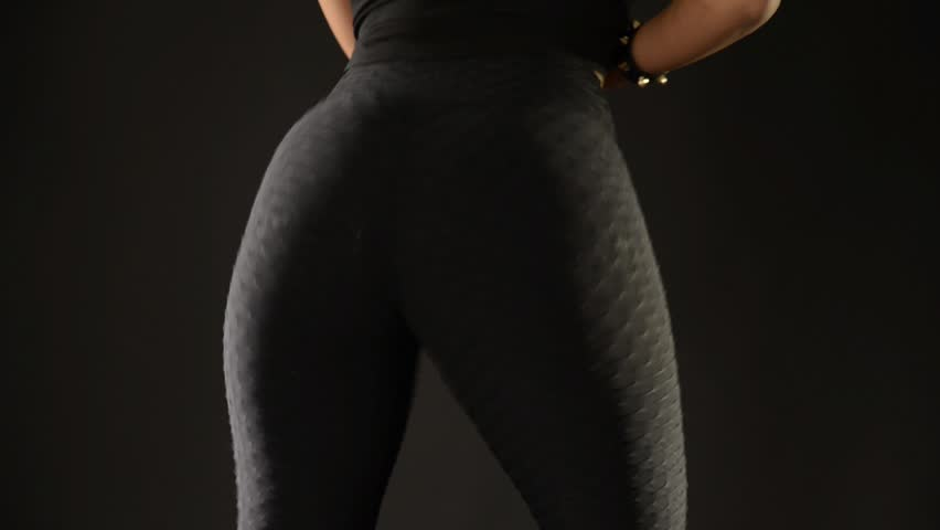 Sensual woman twerking on black background front