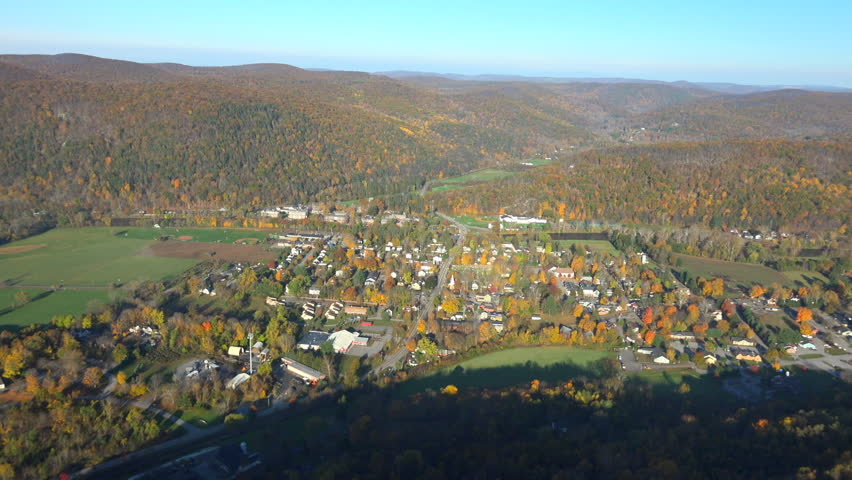 NE village aerial, Kent Ct. Looking West, late fall. Fall 4K aerial landscapes. Shot in the NY, Hudson Valley, Conn, Mass border just below The Berkshires.