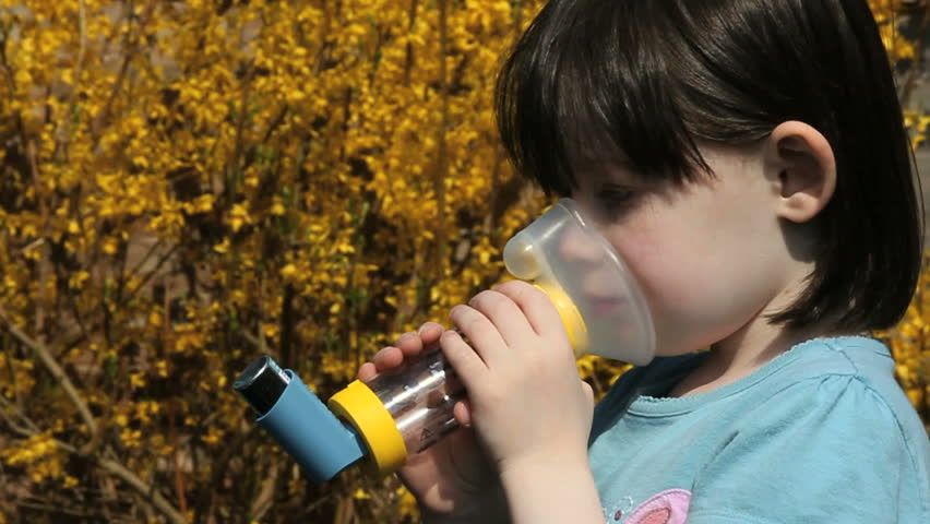 child using asthma inhaler slow motion in slow motion.