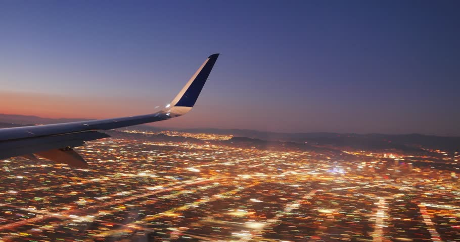 Jet plane landing in Los Angeles LAX airport. Window view with wing. 4K UHD Timelapse.