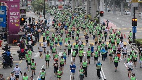 Kuala Lumpur, Malaysia-Oct 12 2014: Standard Chartered Kuala Lumpur Marathon on Sunday 12 Oct. Over 30,000 runners and supporters run through the Jalan Tuanku Abdul Rahman road from Dataran Merdeka.