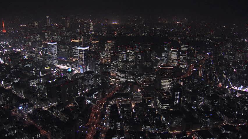 Aerial Metropolis Tokyo night illuminated cityscape offices skyscrapers city blocks structure growth Business District Japan Asia | Shutterstock HD Video #7792459