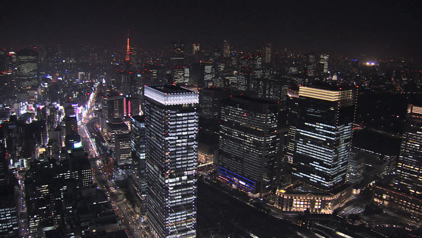 Aerial Metropolis night illuminated entertainment area offices skyscrapers Tokyo Tower city blocks structure Business District Japan | Shutterstock HD Video #7792498