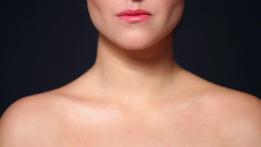 Part of beautiful woman head showing tongue