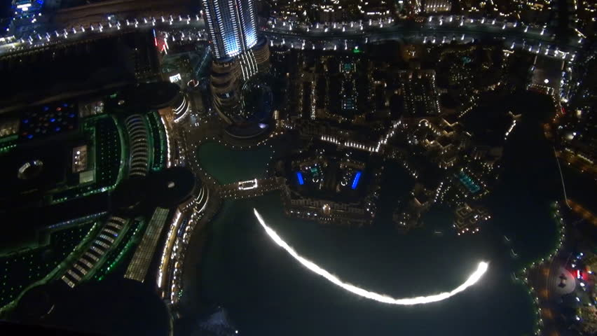 DUBAI - UAE, JANUARY 25, 2014, Timelapse of famous fountain during water show by night, handheld panoramic view | Shutterstock HD Video #7832560