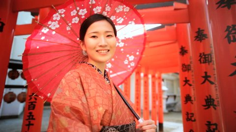 Asian Japanese female Japan traditional costume kimono parasol Buddhist temple symbol travel tourism advertisement slow motion
