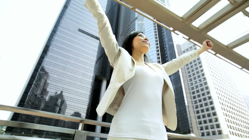 Smart city suit female ethnic Asian Chinese corporate business manager outdoors downtown financial district celebrating successful ambitions | Shutterstock HD Video #7851469