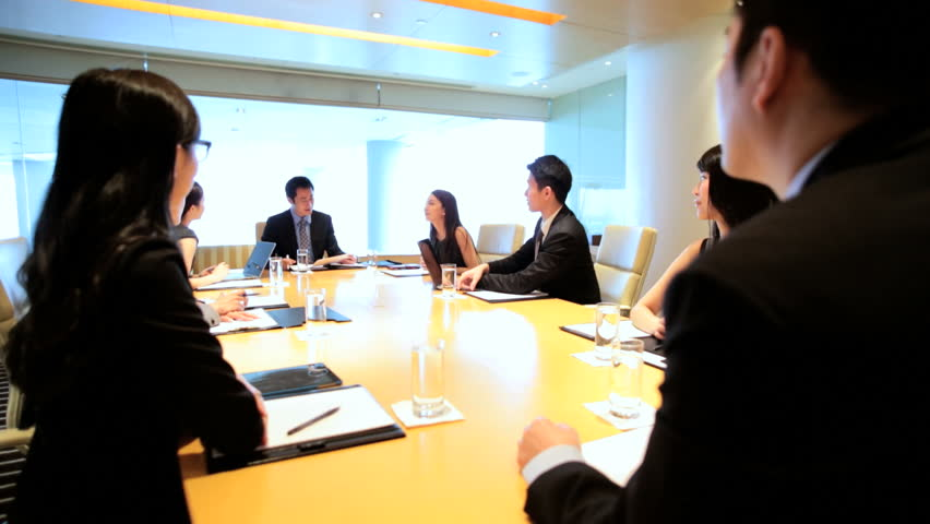Ethnic Asian Chinese smart businessmen businesswomen corporate management conference meeting wireless laptop device planning | Shutterstock HD Video #7852039