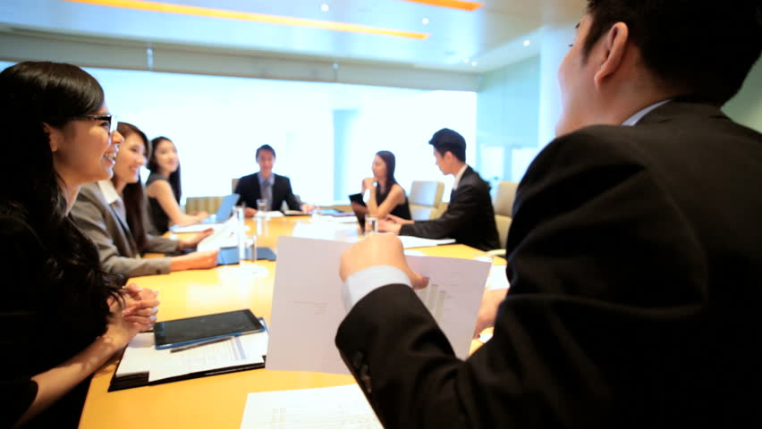Asian Chinese male female business executives consultants city boardroom meeting teamwork communication conference wireless device | Shutterstock HD Video #7852195