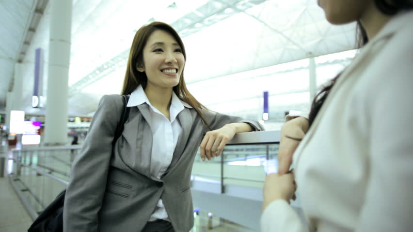 Two female Asian Chinese brunette businesswomen consultant airport departures hall travel destination professional corporate executive meeting   Shutterstock HD Video #7854169