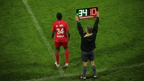 Srbija,Krusevac,2014. FC Napredak-FC Radnicki. Football. Soccer. Substitution. Players and referee. Soccer judge. Two football clubs playing championship derby match. Soccer teams have a game. 30 fps.