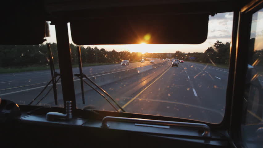Busride. Sunset. Riding at the front of a greyhound bus on Hwy 401, Ontario, Canada. Sunset.