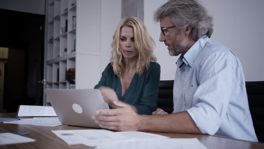 Two Women In Office Teasing Man Working With Computer-5065