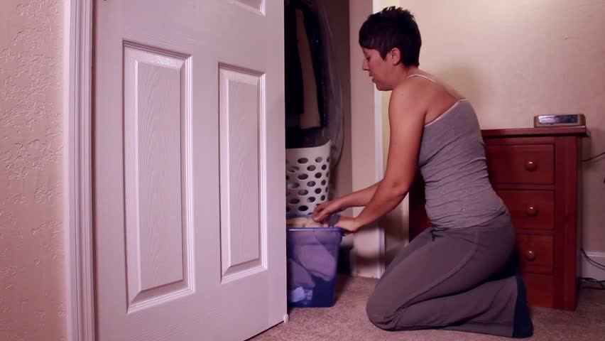 Woman tossing clothes out of the closet  | Shutterstock HD Video #8001169