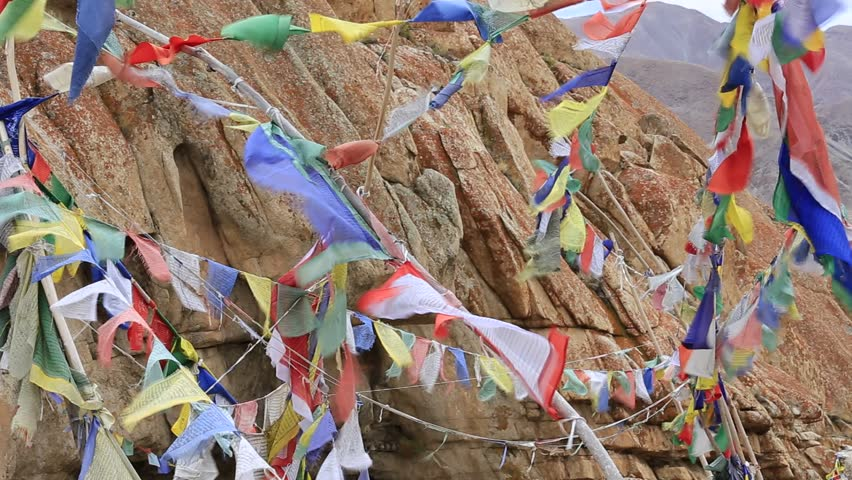 Plenty of colorful Buddhist prayer flags on the Stupa near Takthok gompa, Buddhist monastery in Ladakh, Jammu & Kashmir, India | Shutterstock HD Video #8055439