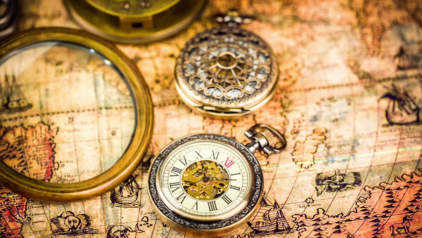 Vintage antique pocket watch on ancient world map in 1565 stock vintage magnifying glass compass telescope and a pocket watch lying on ancient world map gumiabroncs Image collections