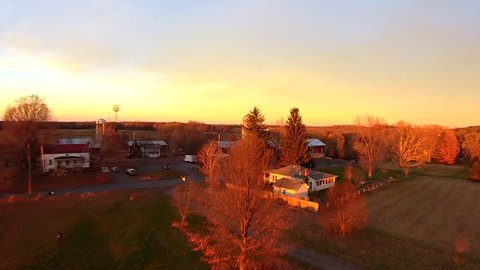 Working farm aerials, sunset light, slow rise. Upstate New York. Float over views of farm, in late afternoon late fall light, very clear light. Aerial Farm views, HD 60FPS close up and personal.
