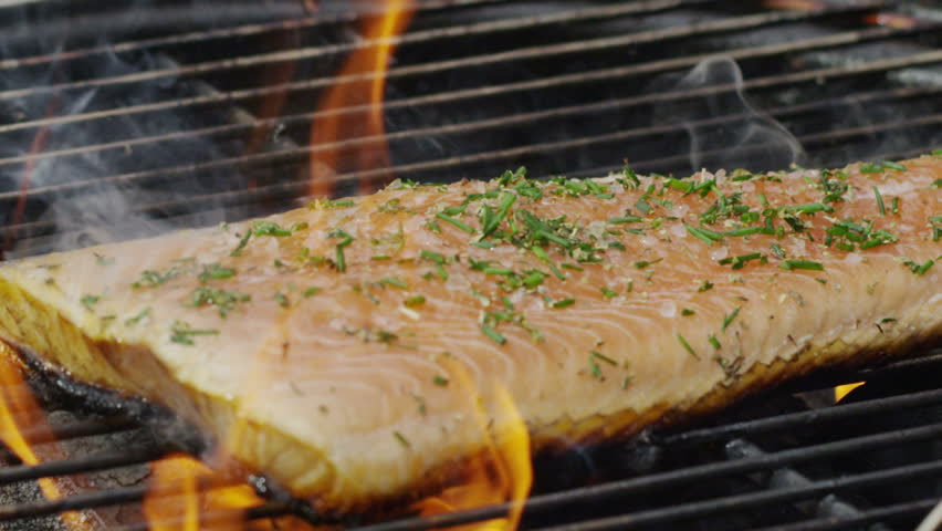Salmon fish on a grill. Summer barbeque.
