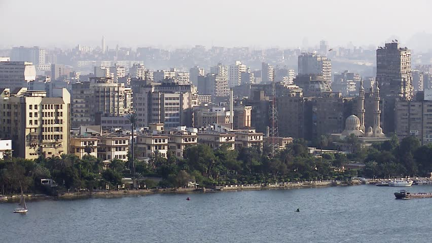 Boat passing Nile river, general view of Cairo. Cairo is the capital of Egypt and the largest city in the Middle-East and second-largest in Africa after Lagos.