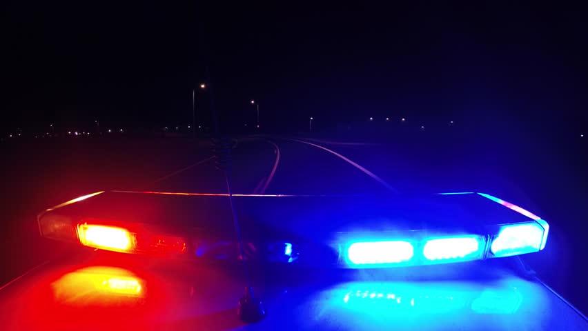 police car flashing light POV