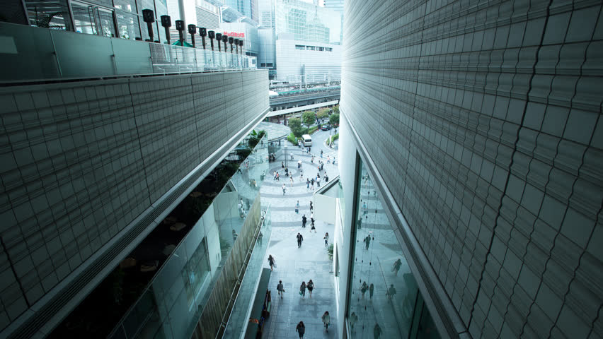 Time lapse wide view of people walking in the Yurakucho office area, Tokyo, Japan | Shutterstock HD Video #8242219