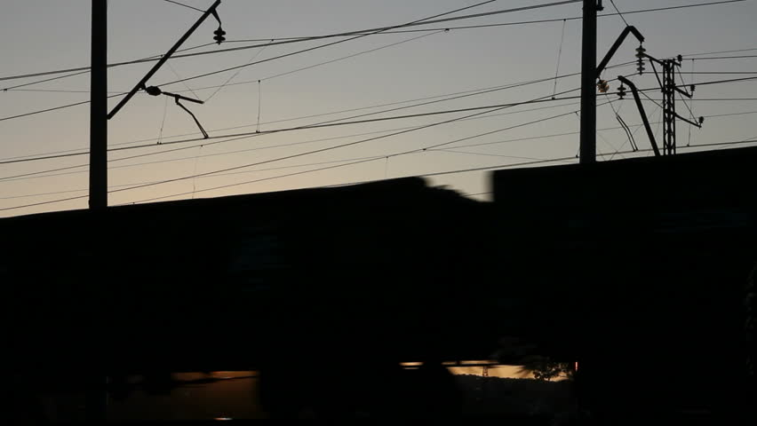 time-lapse with freight train against sunset