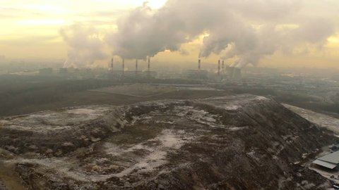 Polluting factory at dawn,aerial vew, near the dump