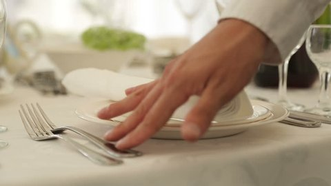 the waiter in the restaurant serving banquet in white colors