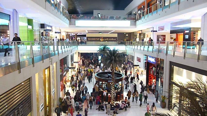 DUBAI, UAE - FEBRUARY 19: Shoppers shopping at Dubai Mall 7th largest mall in the world February 19, 2010 in Dubai, United Arab Emirates.