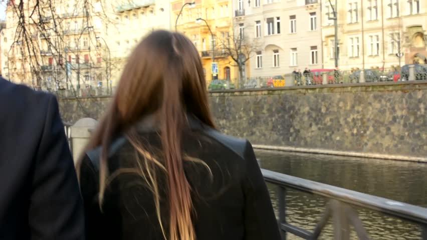 Happy couple walks in city - shot from back | Shutterstock HD Video #8338669