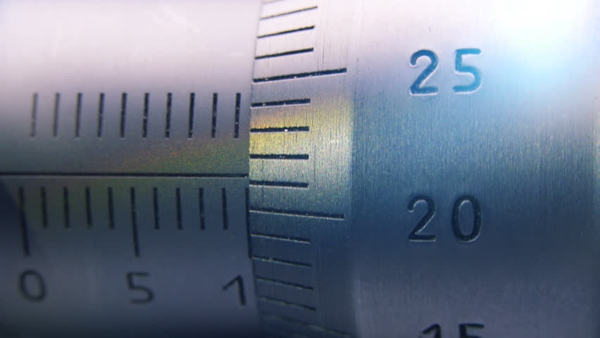 Precision measuring instrument. Thickness measuring device. Dolly shot. Closeup