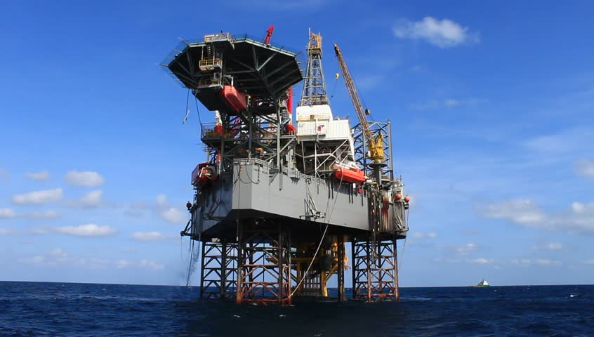 Jack up drilling rig in the middle of the ocean view from the crew boat