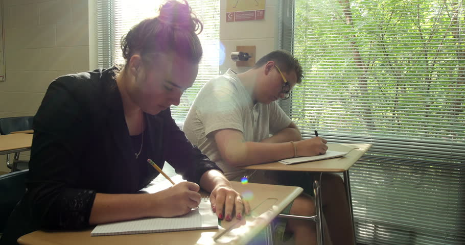 High school students quietly working, taking notes and doing their school assignments & homework in class. Ultra HD 4K    Shutterstock HD Video #8396530
