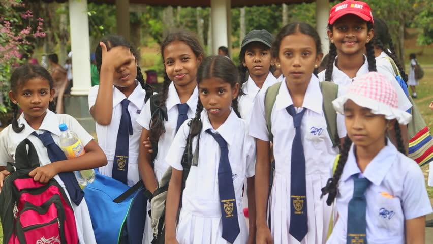 Tree Schoolgirl In Uniform Near Kandy On Sri Lanka Stock