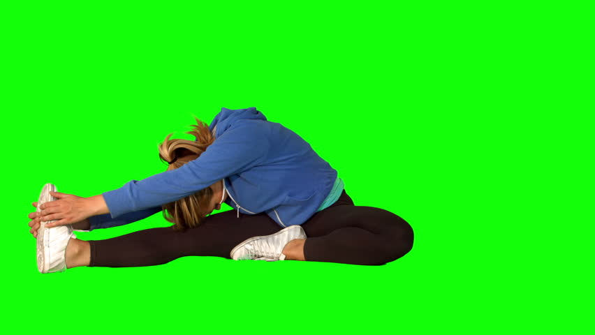 Fit woman sitting on the floor stretching her legs on green screen background in ultra hd format   Shutterstock HD Video #8414239
