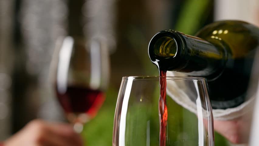 Sommelier filling glass with wine in restaurant. 4K, UHD | Shutterstock HD Video #8548297