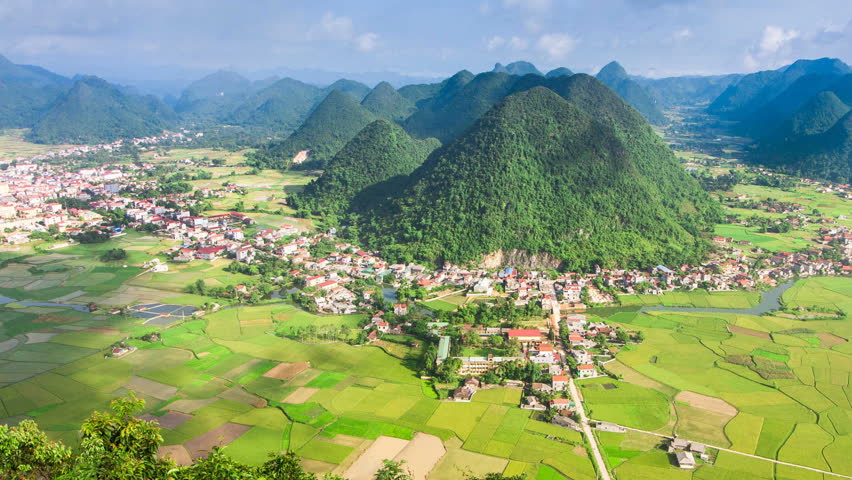 Serene village time lapse in valley with paddy field all around at Bac Son, Long Son, Vietnam | Shutterstock HD Video #8551999