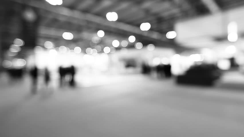 Hd0034people walk visiting a trade show black and white intentionally blurred post production time lapse