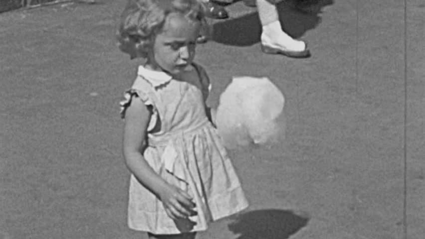 ENGLAND - 1950: child eating cotton candy in 1950 in England